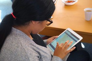 A girl uses an iPad showing the Street Story interface
